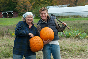 Two people with pumpkins